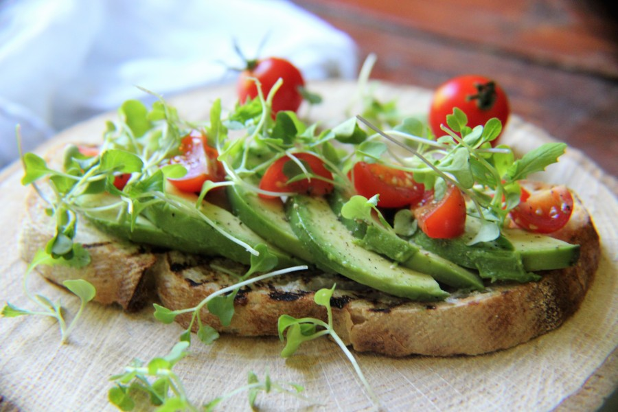 Avocado & Chopped Cherry Tomatoes on Organic Sour Dough Toast with Micro Greens